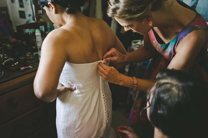 Melbourne wedding bridesmaid helping bride dress