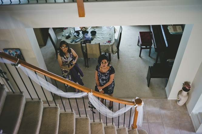 Relatives looking from stairs
