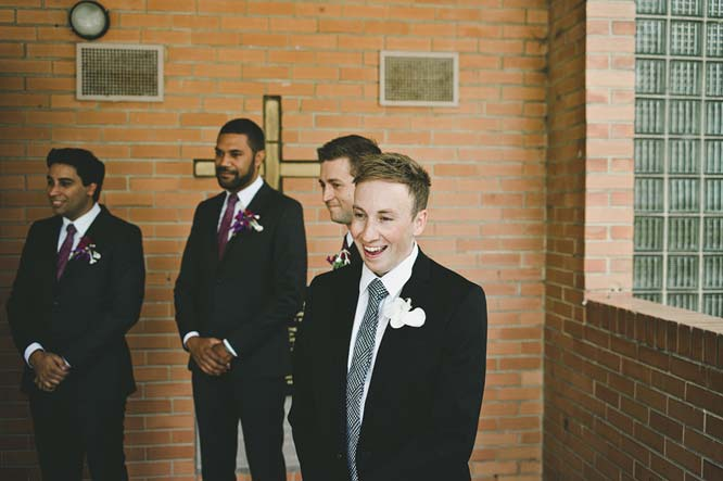 Groom looking at bride arrival