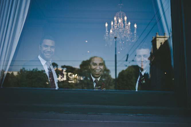 Melbourne Egyptian Wedding best men smiling from window