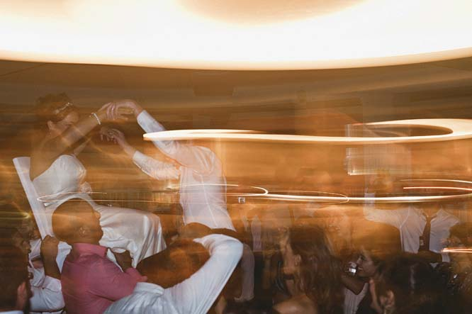 Melbourne Egyptian Wedding Windsor Hotel bride and groom on chair dance