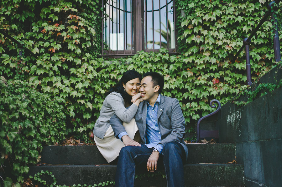 Engagement couple sitting in front of Barracks building