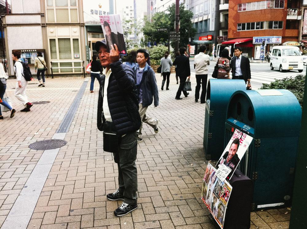Man selling big issue in Kobe Japan