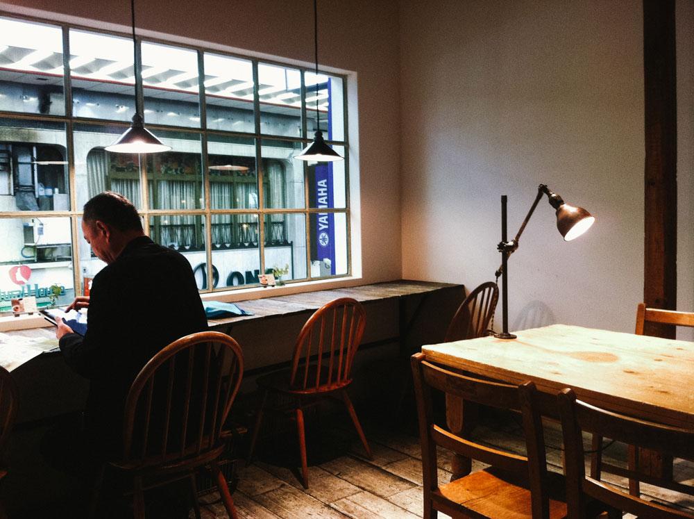 Man and lamp in cafe - Hara donuts, Kobe