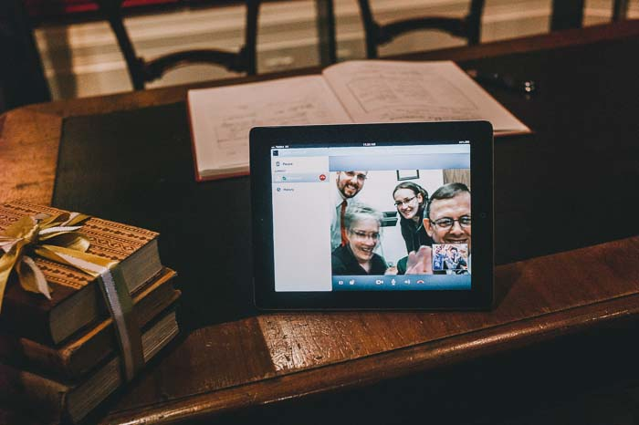 Family attending wedding with Skype on iPad