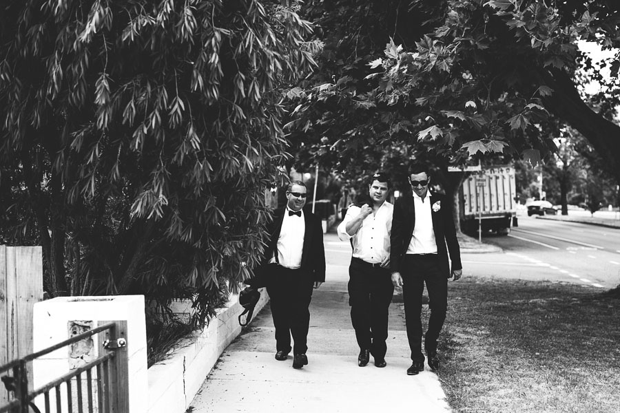 groomsmen walking along ripponlea