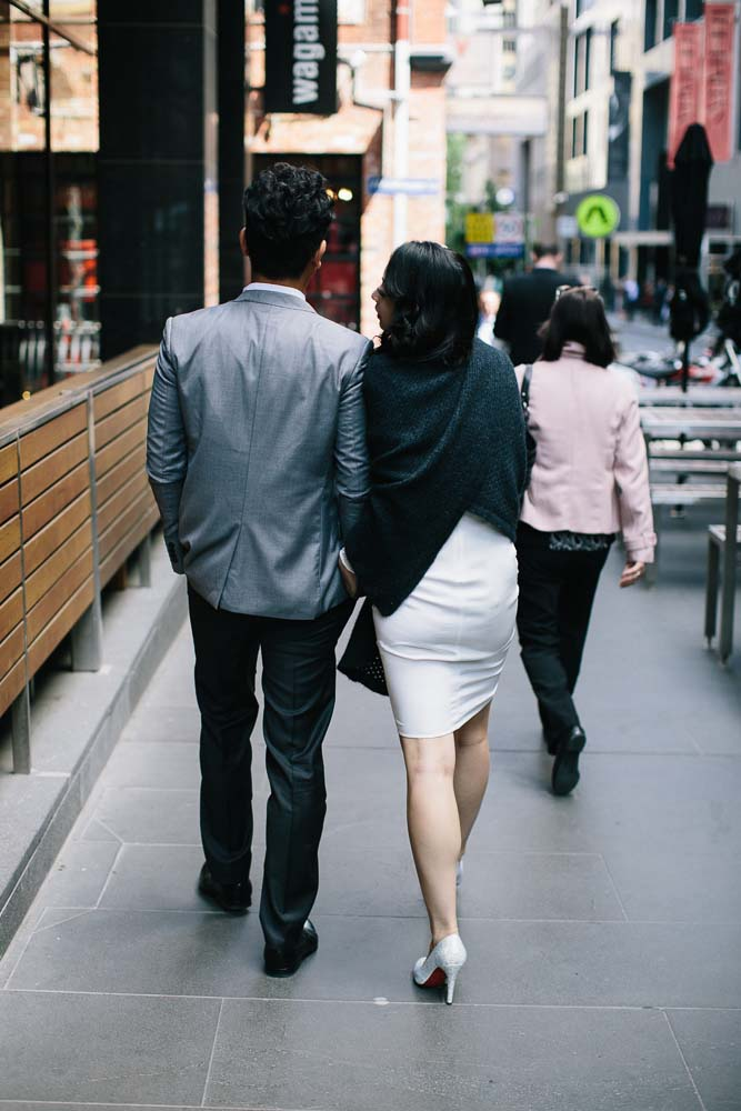 Married couple walking down wagamama flinders lane