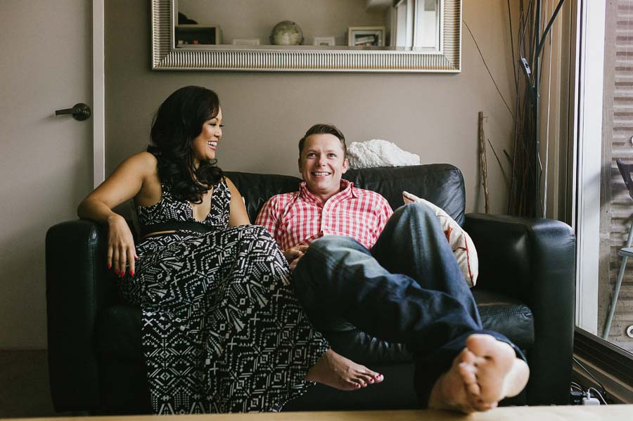 Melbourne engaged couple in apartment couch