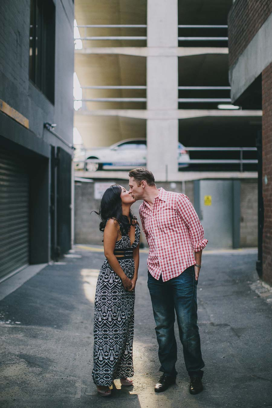 Desiree and Andrew kissing along Bouverie Place