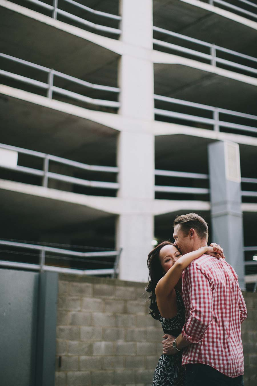 Couple hugging in front of Melbourne parking lot