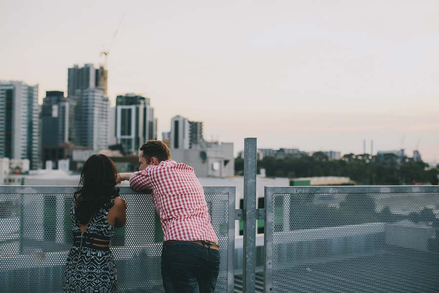 Melbourne couple rooftop scenery engagement