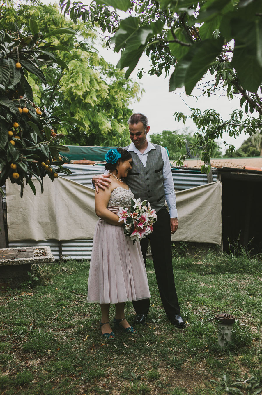 Coburg backyard PepperTree wedding couple