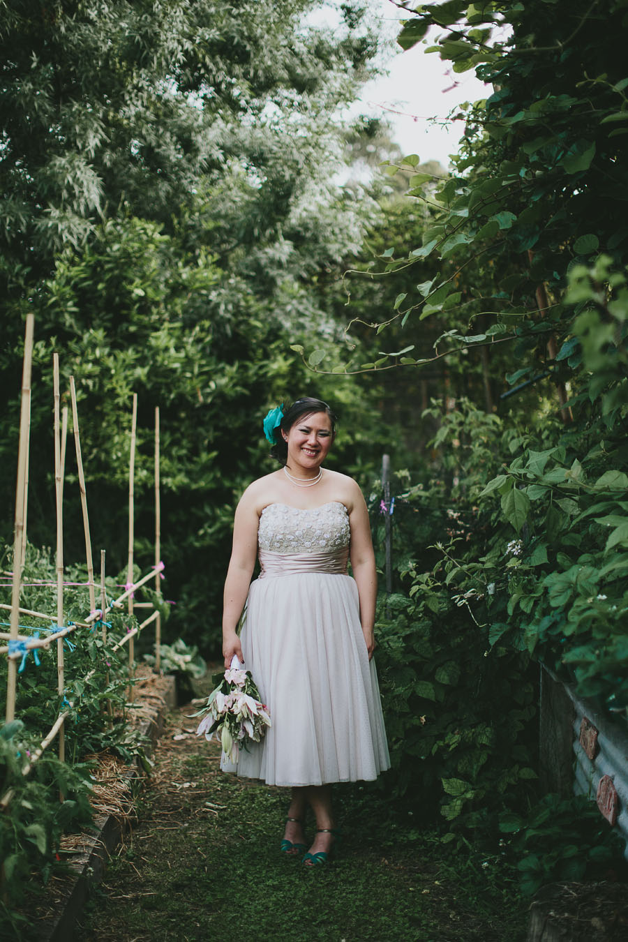 Bride smiling in Coburg Community garden