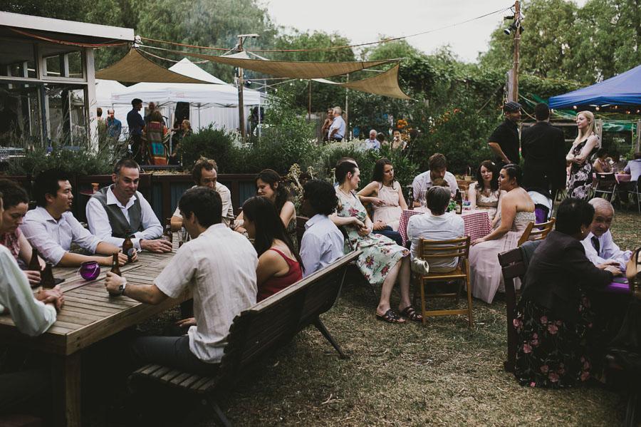 Guests socialising wedding reception Coburg Community garden