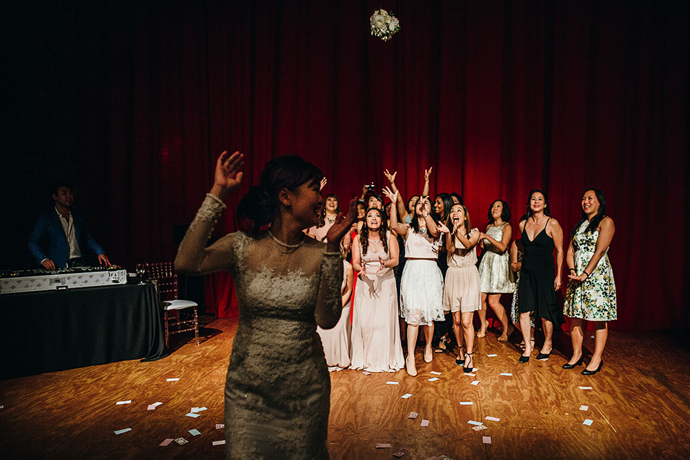 substation-newport-wedding-photographer-reception-tina-dennis-bouquet-toss