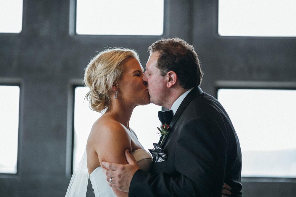 MONA-wedding-photographer-organ-room-kiss