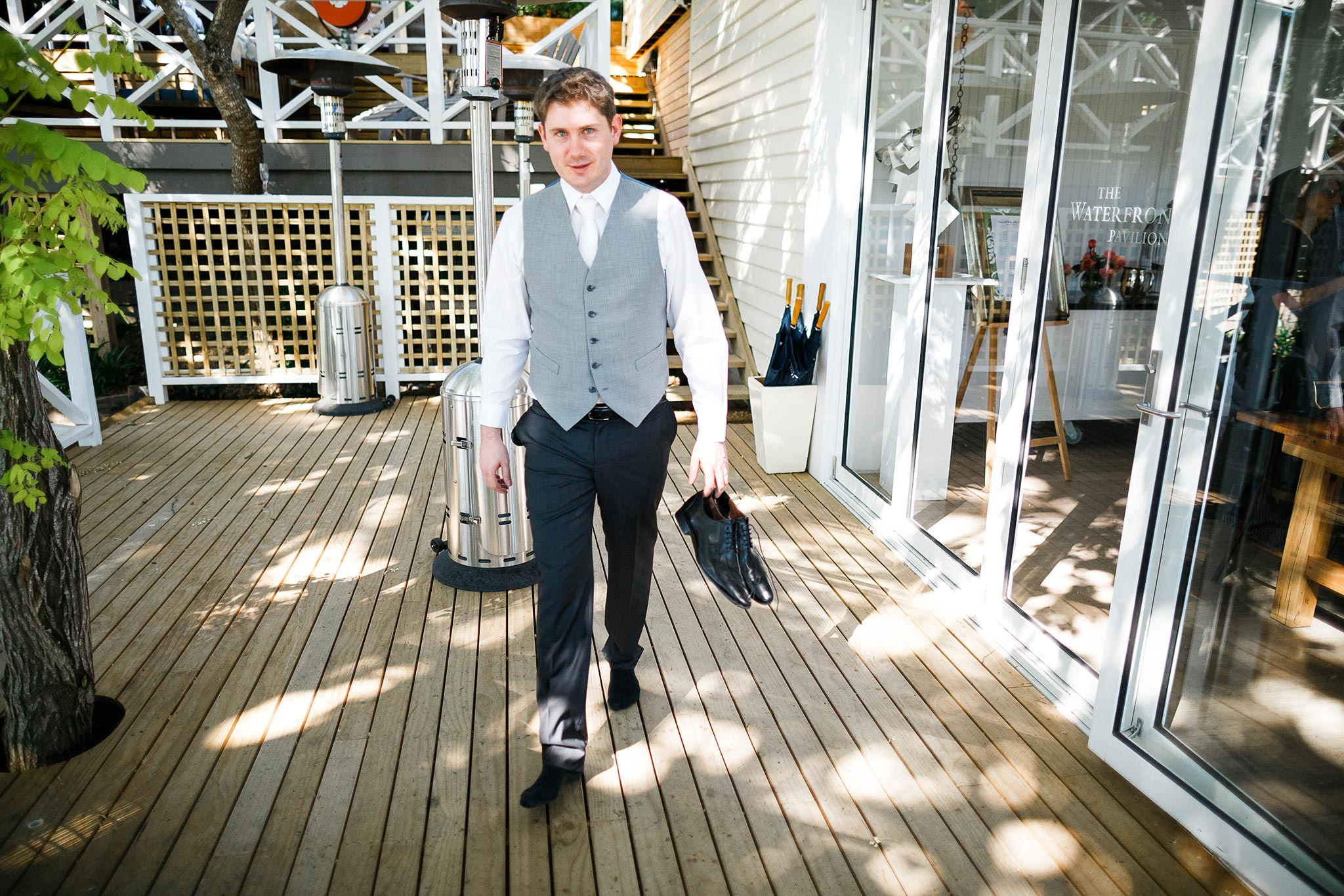 Daylesford-Lake-House-Wedding-Photographer-lunch-reception-groom-leaving