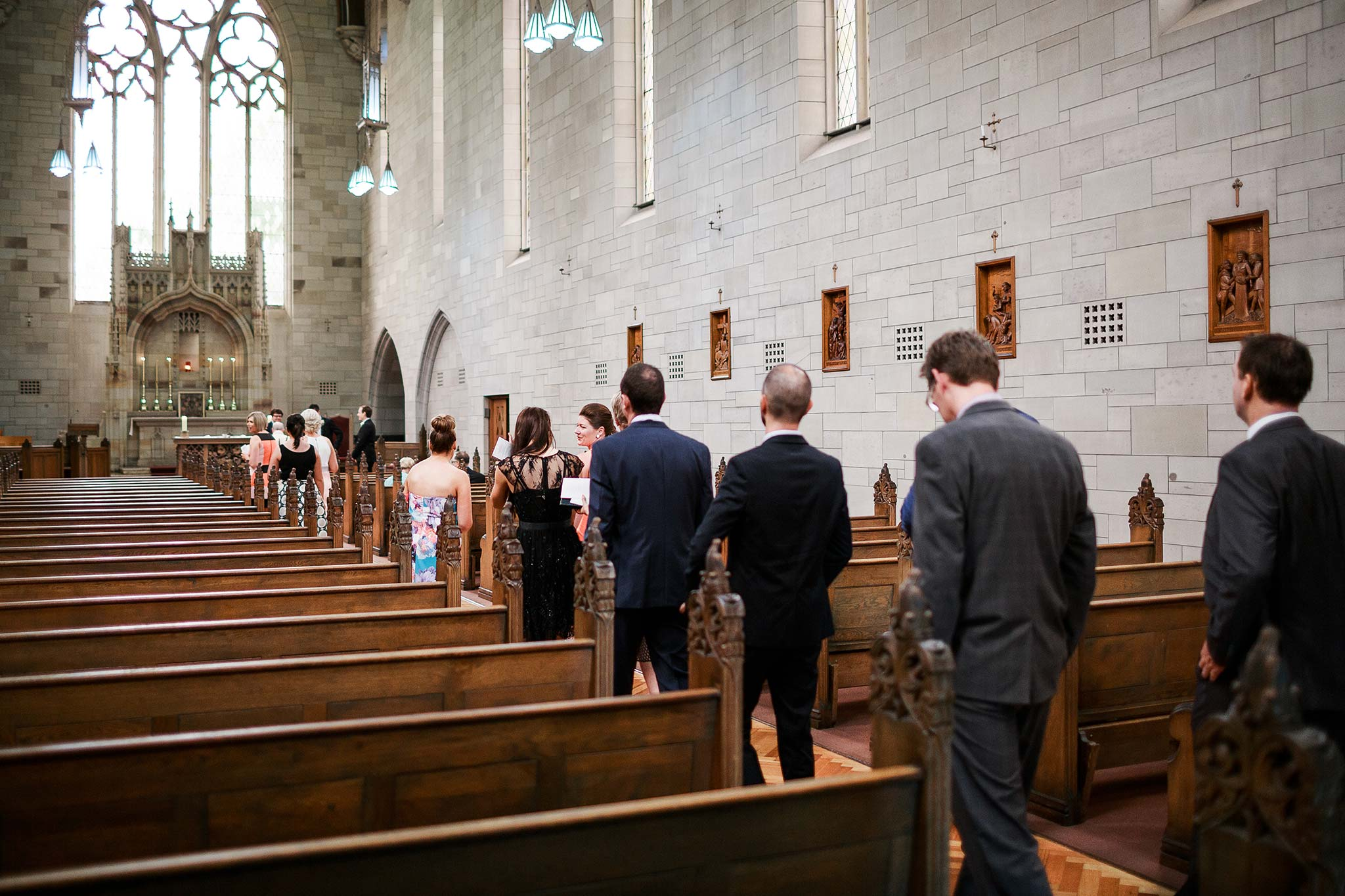 Newman-college-wedding-photographer-ceremony-guests-arrival