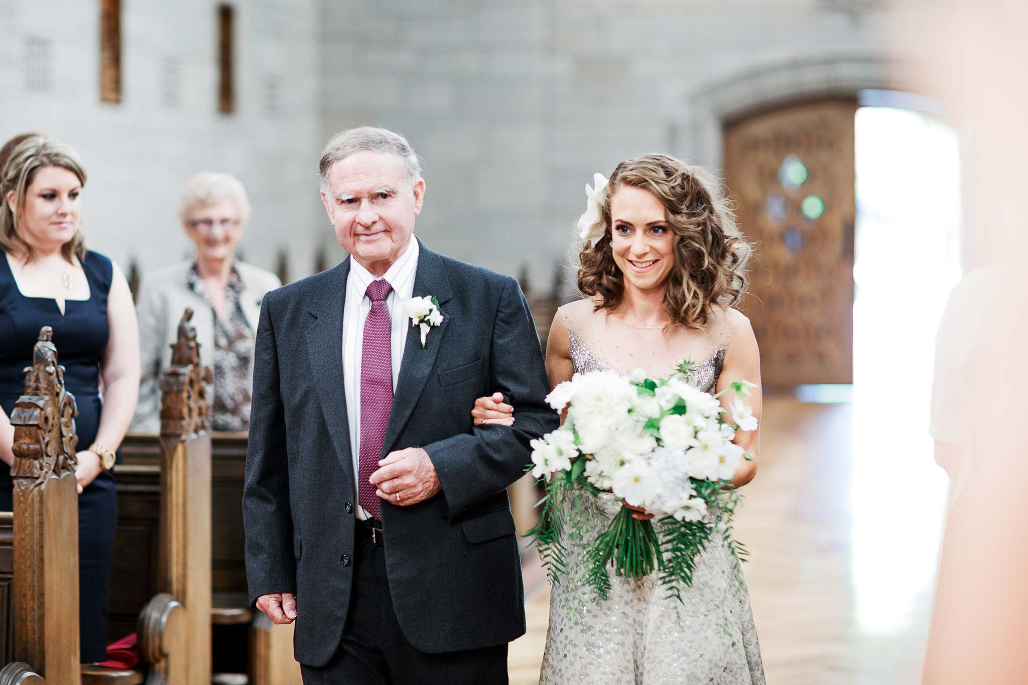 Newman-college-wedding-photographer-ceremony-walk-aisle