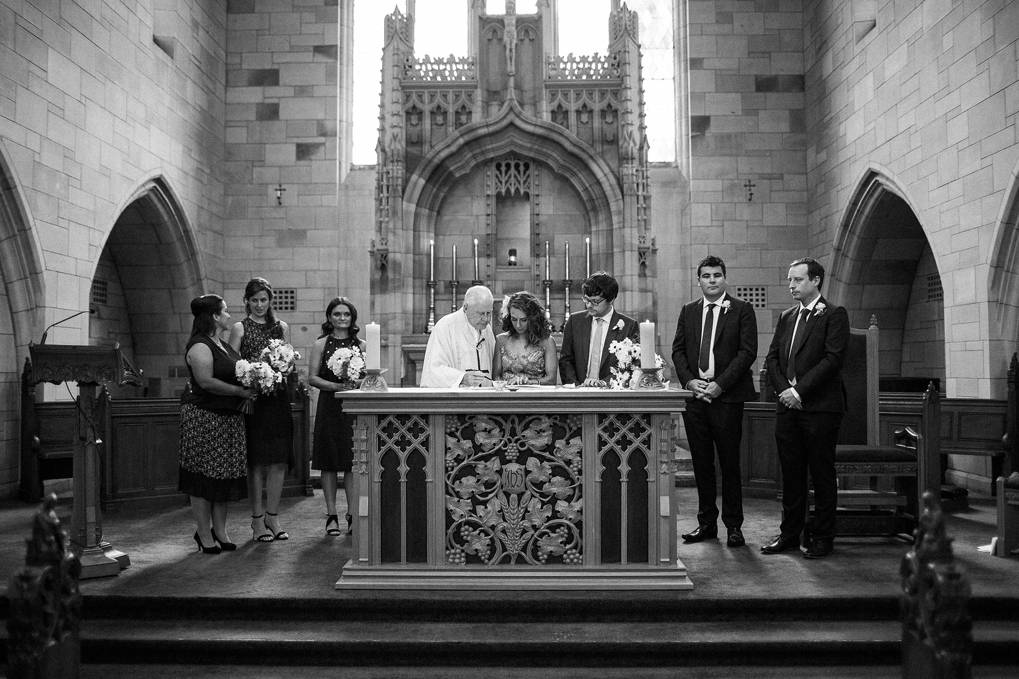 Newman-college-wedding-photographer-ceremony-signing