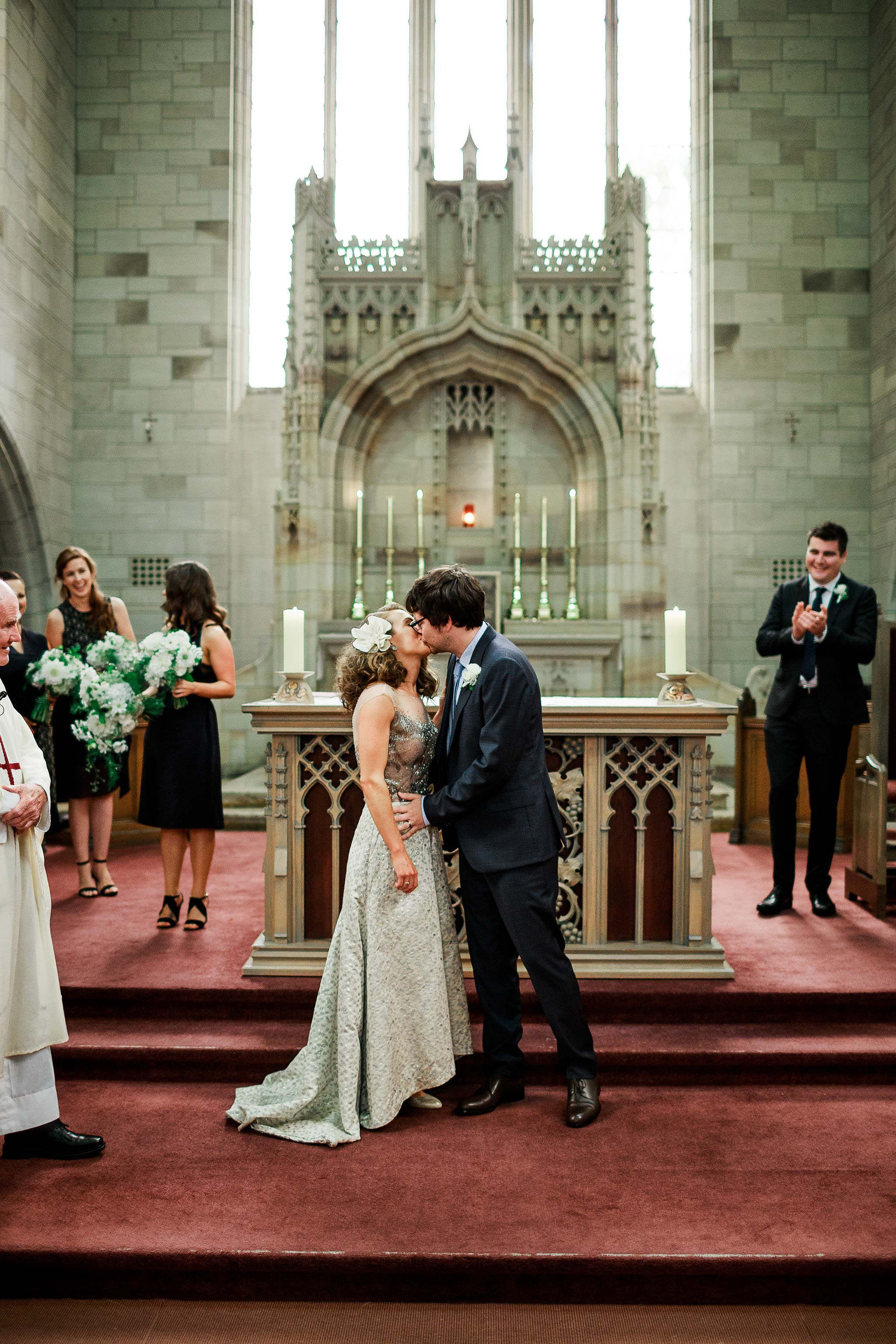 Newman-college-wedding-photographer-ceremony-kiss
