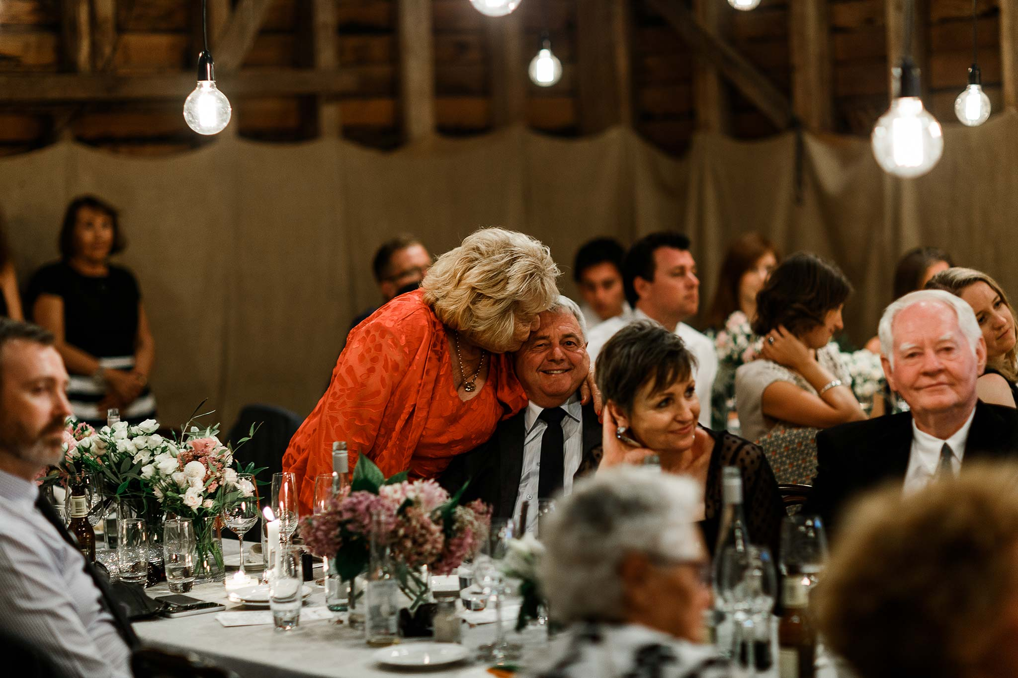 Launceston-Brickendon-barn-Wedding-Photographer-reception-kiss