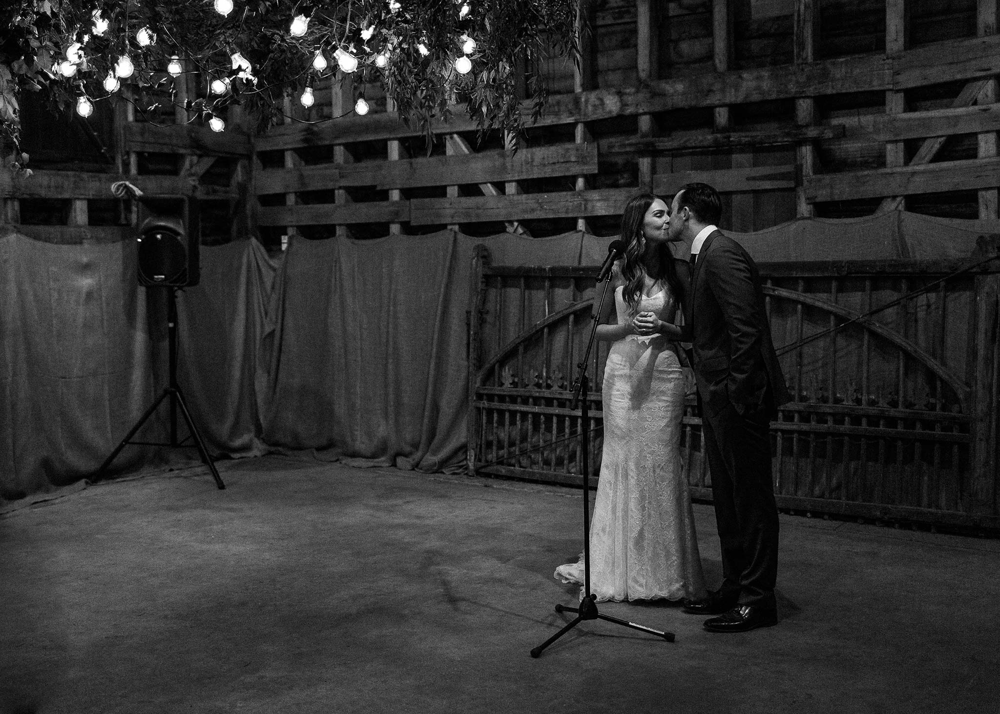 Launceston-Brickendon-barn-Wedding-Photographer-reception-speech-kiss
