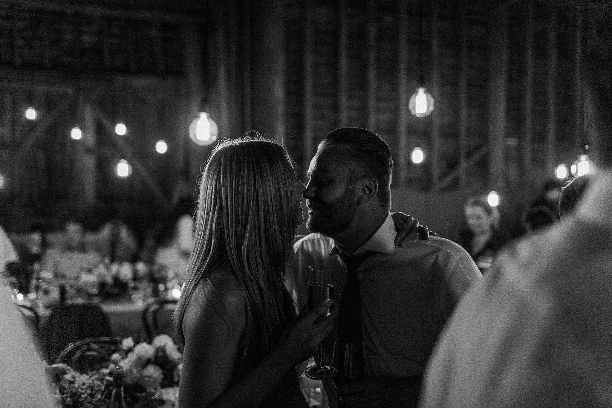 Launceston-Brickendon-barn-Wedding-Photographer-reception-guest-kiss