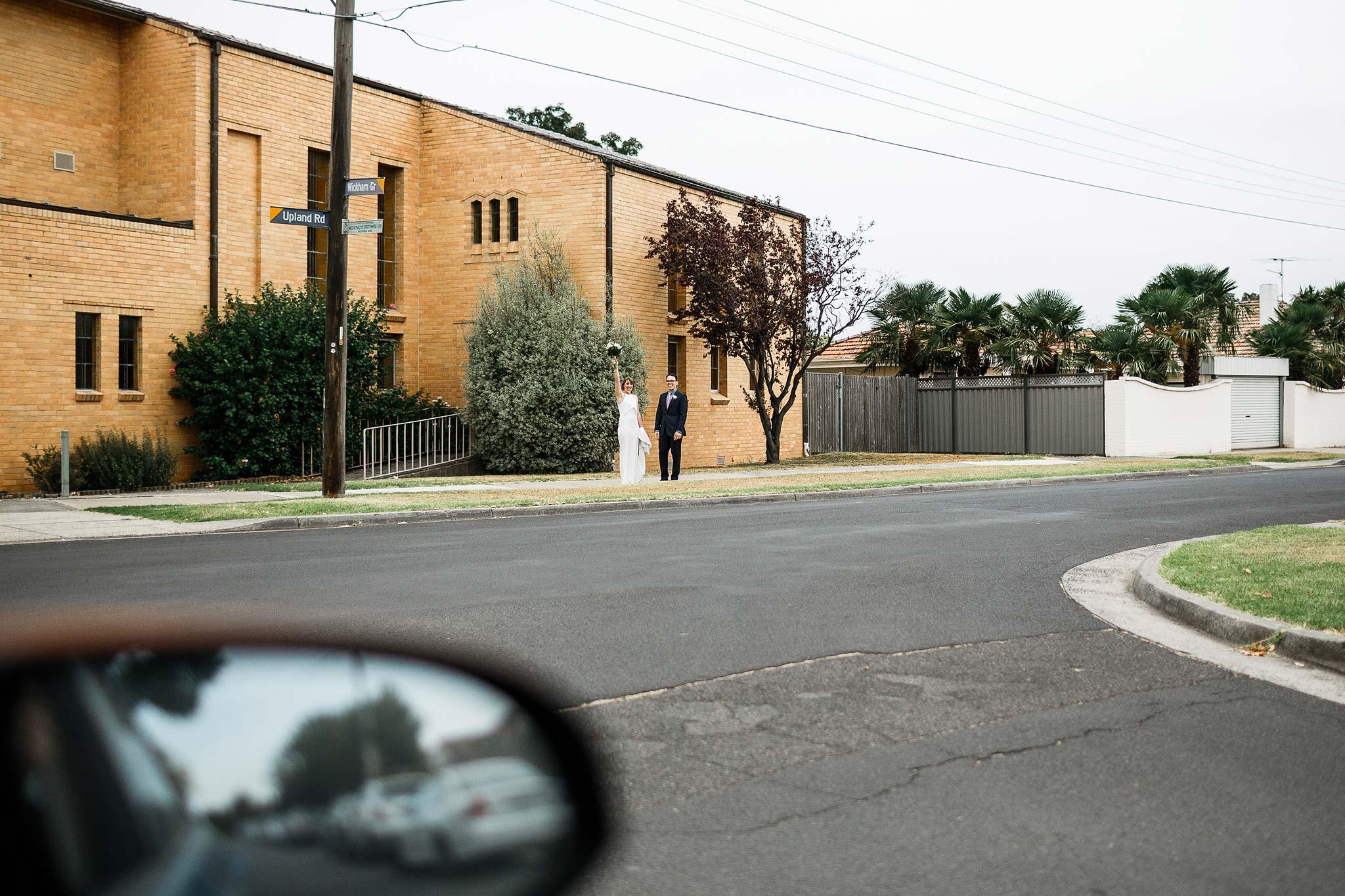 Strathmore-Melbourne-Backyard-Wedding-bride-groom-waving