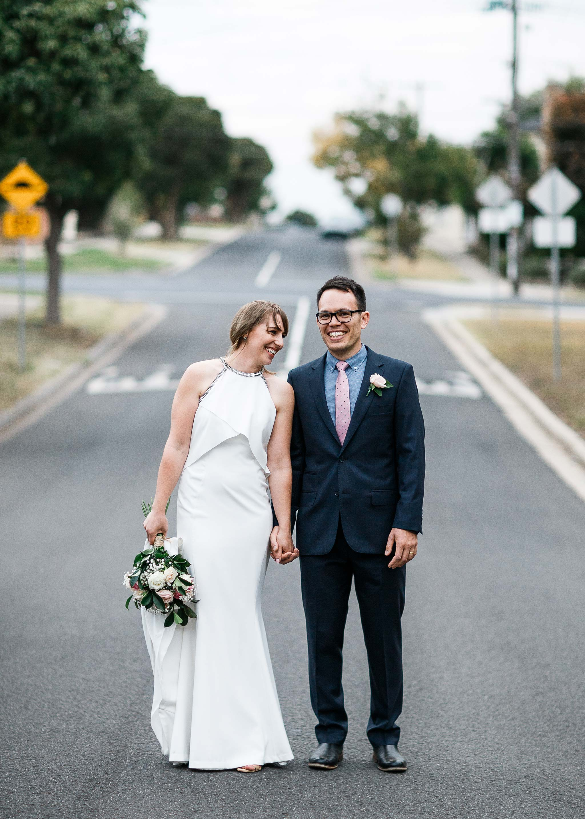Strathmore-Melbourne-Backyard-Wedding-bride-groom-middle-road