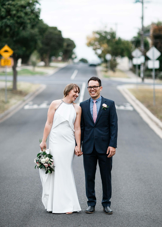 Strathmore-Melbourne-Backyard-Wedding-bride-groom-middle-road