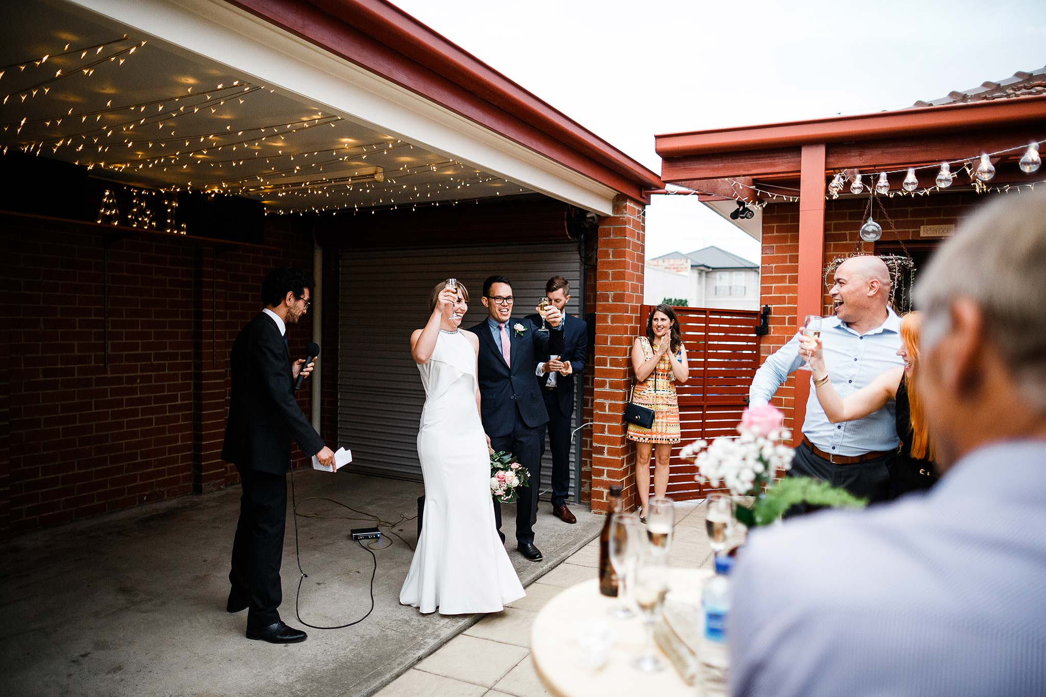 Strathmore-Melbourne-Backyard-Wedding-reception-cheers