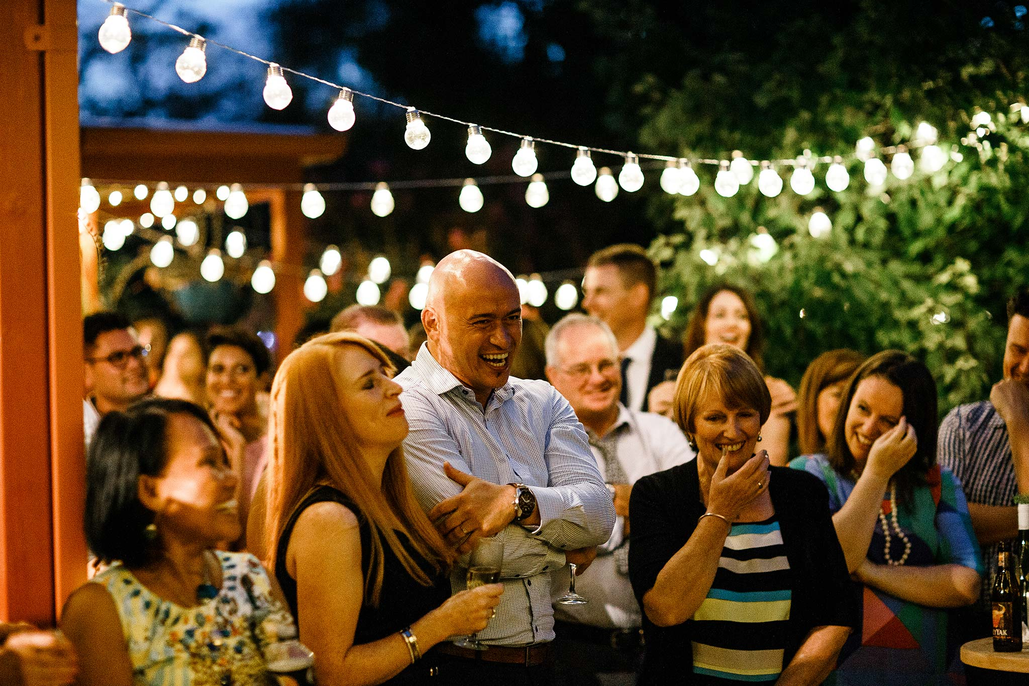 Strathmore-Melbourne-Backyard-Wedding-reception-guests-laughing