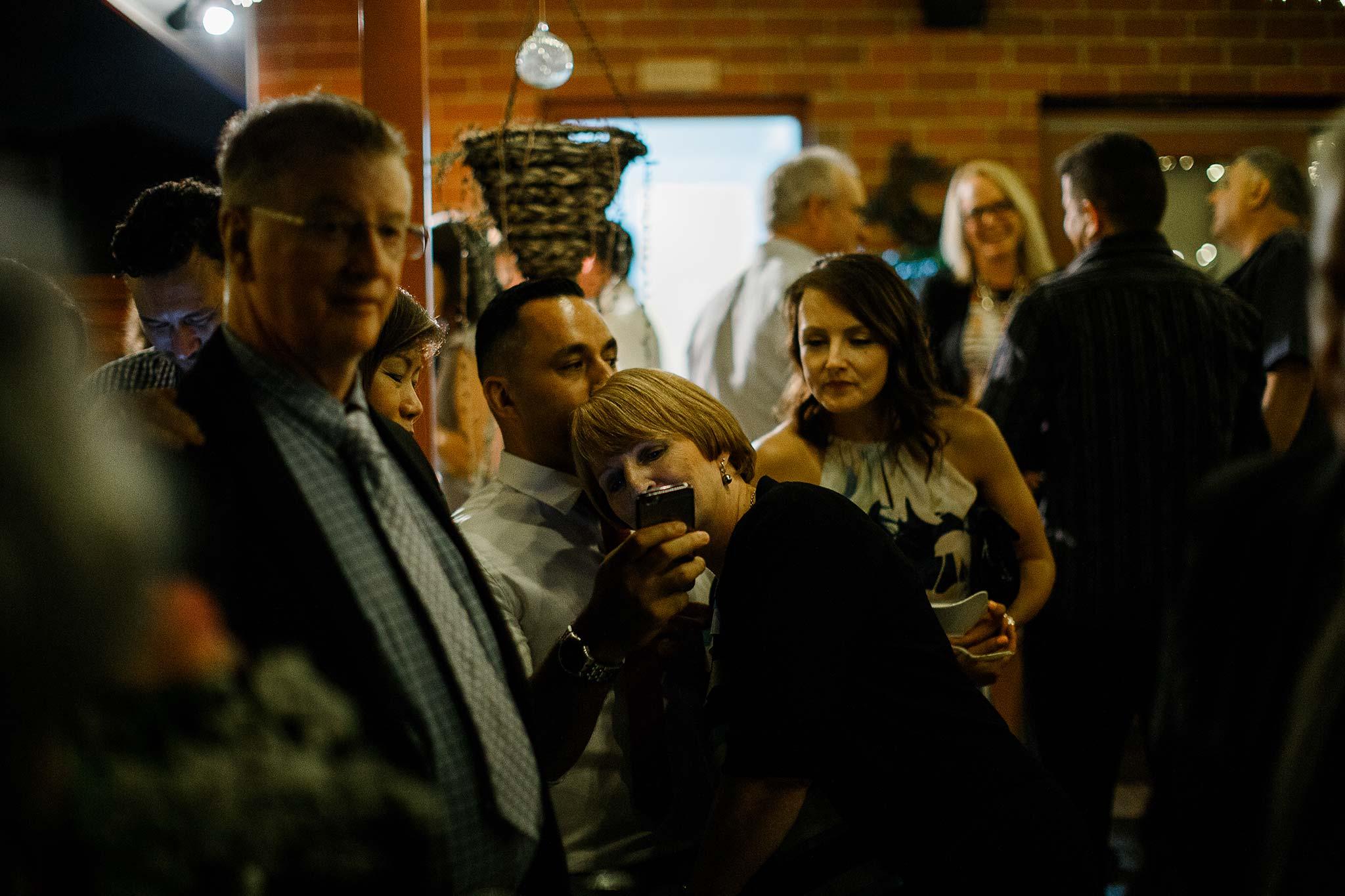 Strathmore-Melbourne-Backyard-Wedding-reception-guests-fooling