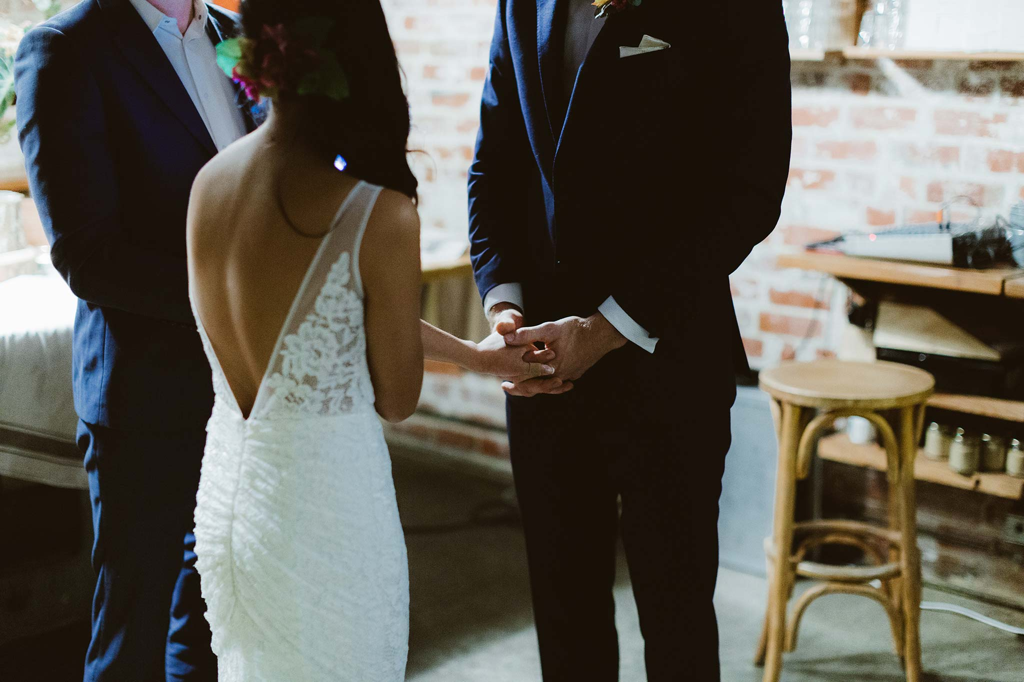 Melbourne-North-Carlton-East-Elevation-Surprise-Winter-warehouse-Wedding-photographer-hold-hands