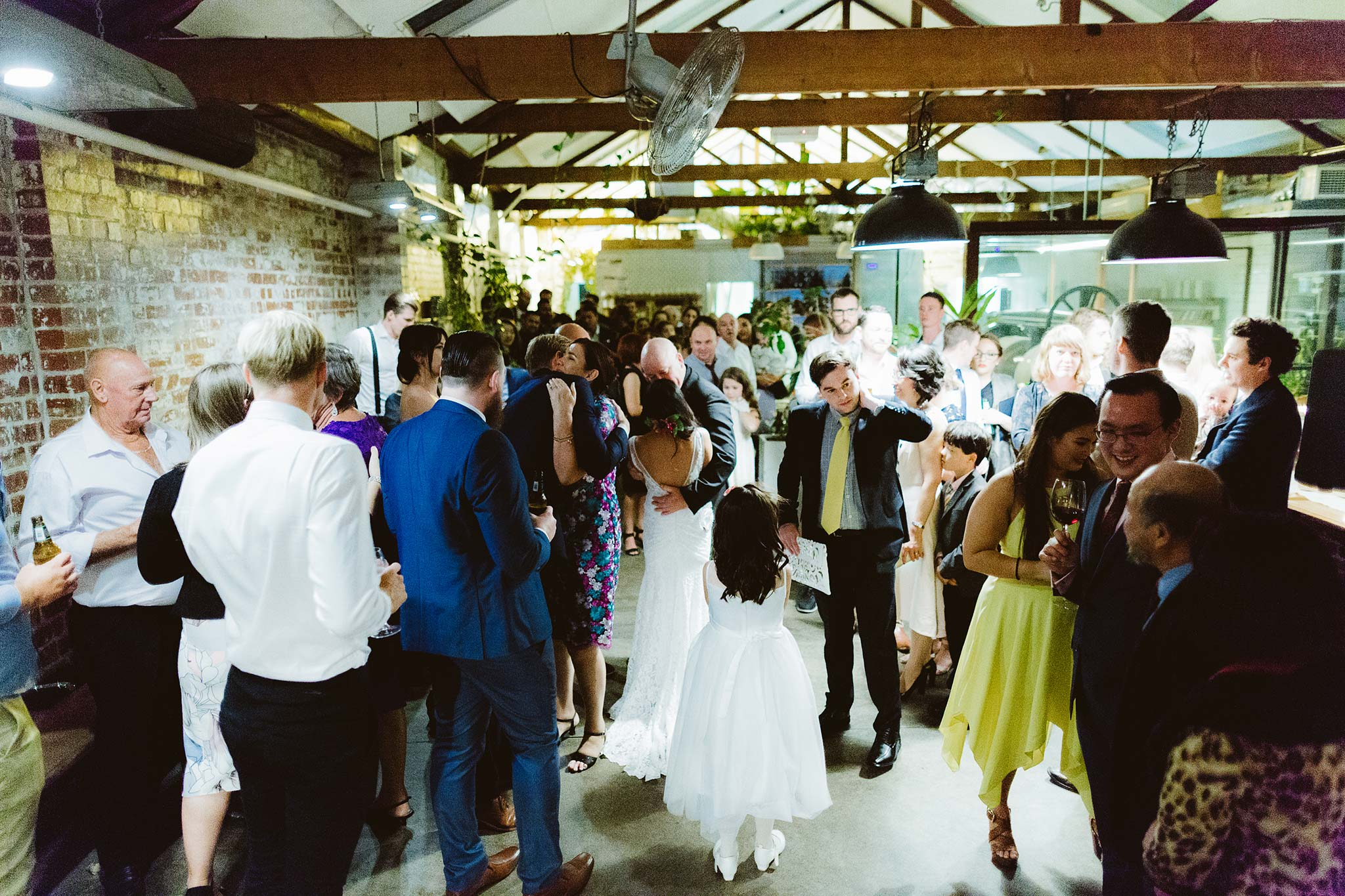 Melbourne-North-Carlton-East-Elevation-Surprise-Winter-warehouse-Wedding-photographer-guests-wishing