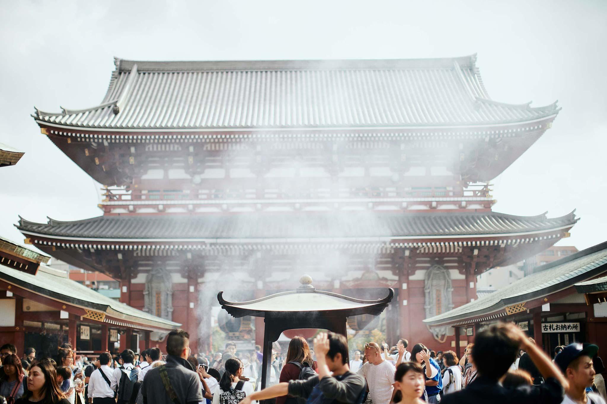 tokyo asakusa shrine traditional wedding smoke from temple and tourists