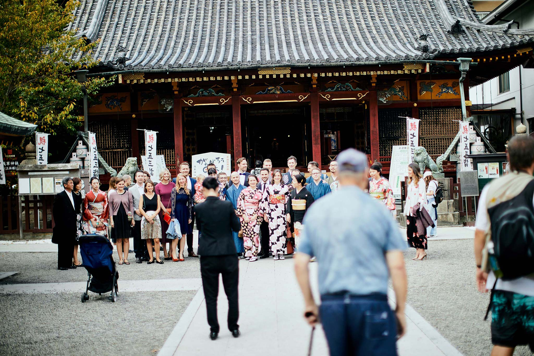 tokyo asakusa shrine traditional wedding guest group photo