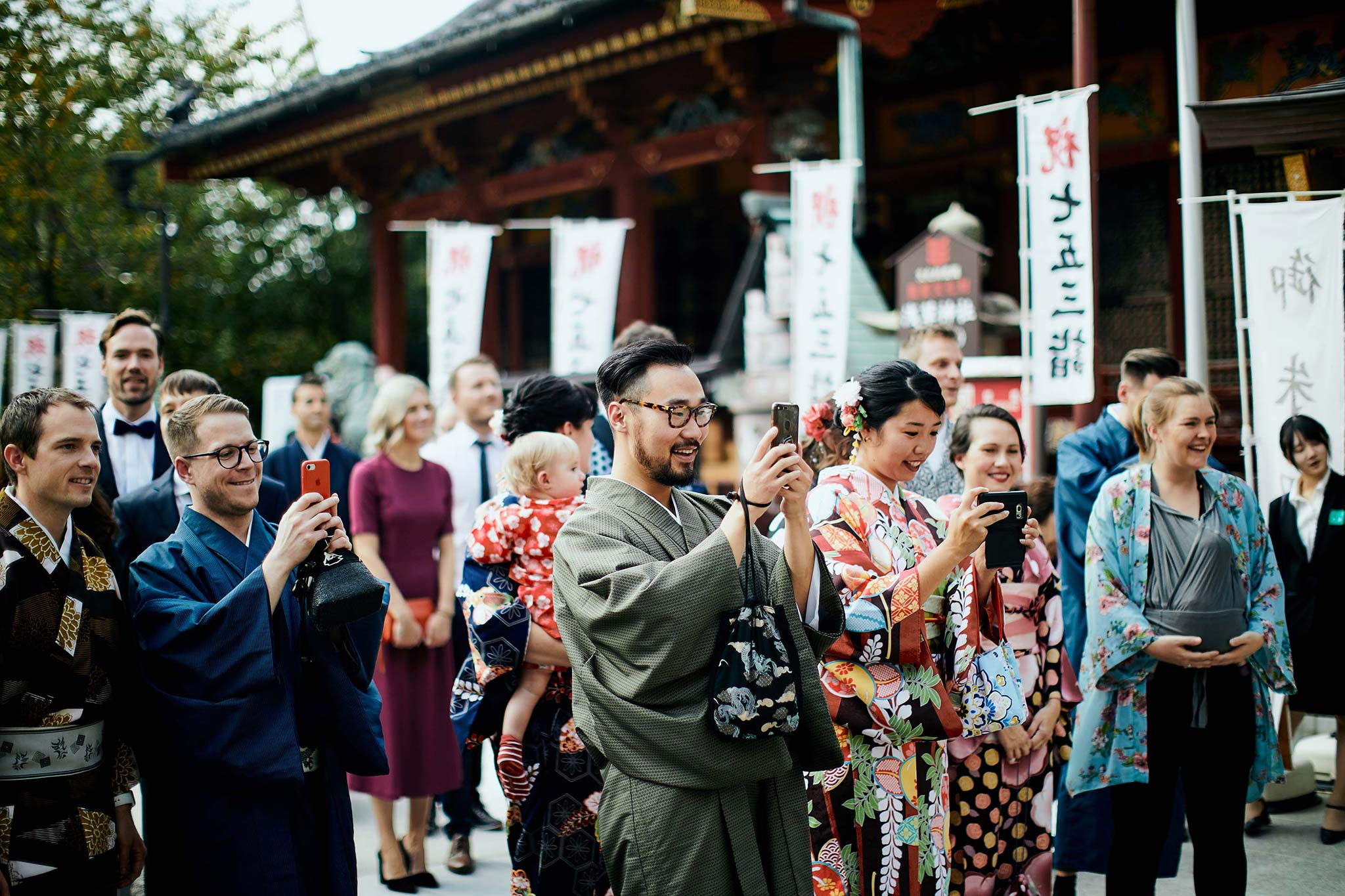 tokyo asakusa shrine traditional wedding guests taking photos