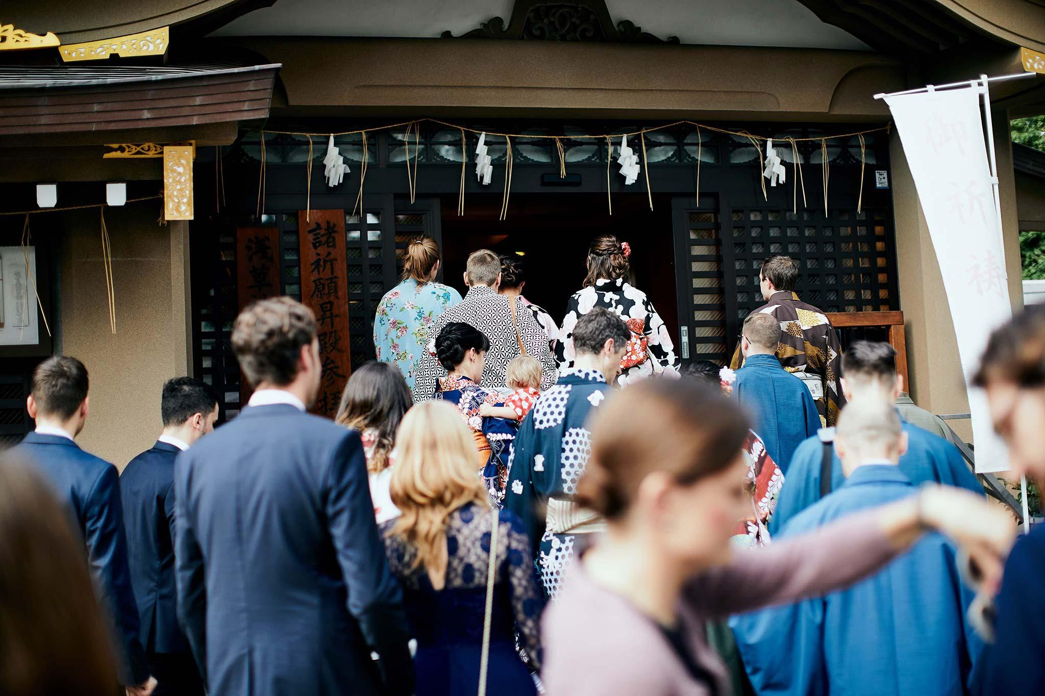 tokyo asakusa shrine traditional wedding guests entering