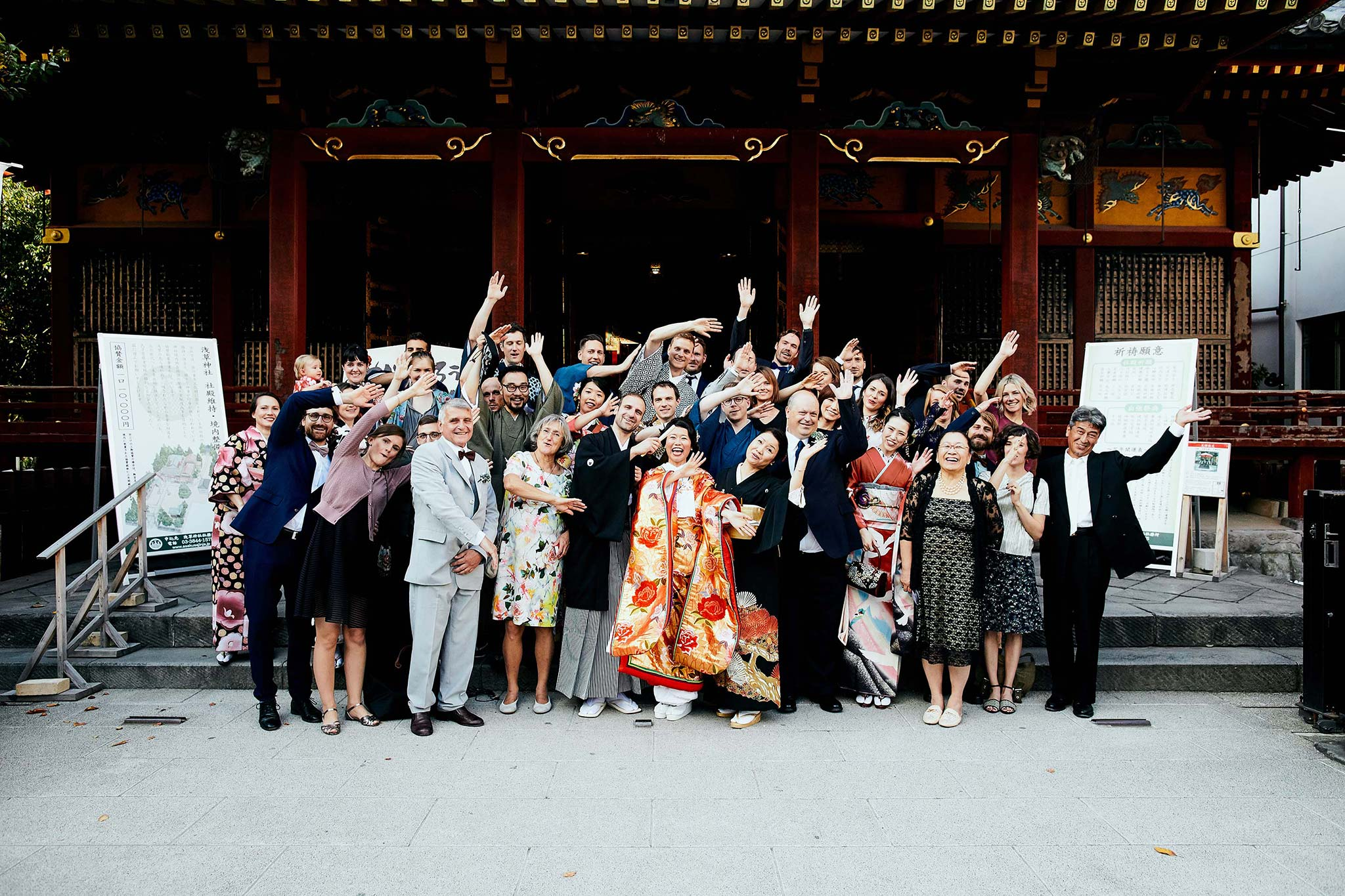 tokyo asakusa shrine traditional wedding group portrait mexican wave