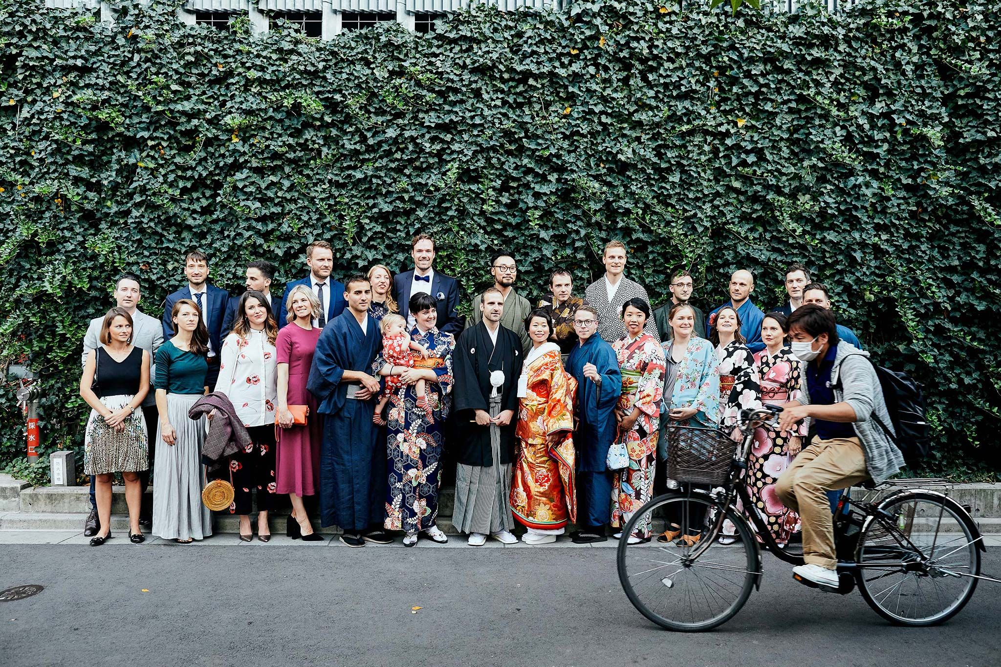 tokyo asakusa shrine traditional wedding group photo disturbed by bike