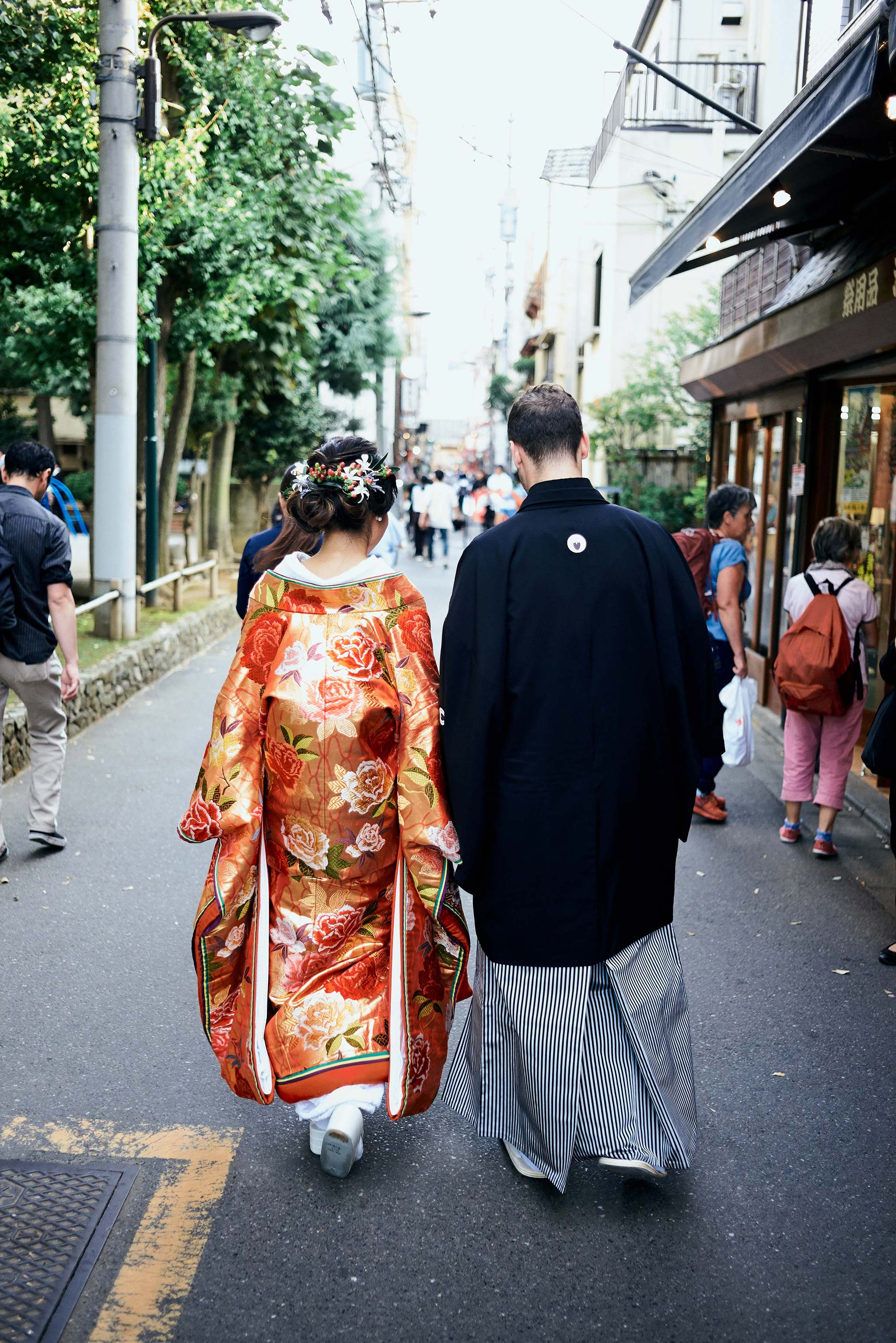 tokyo asakusa shrine traditional wedding bride groom walking view from the back