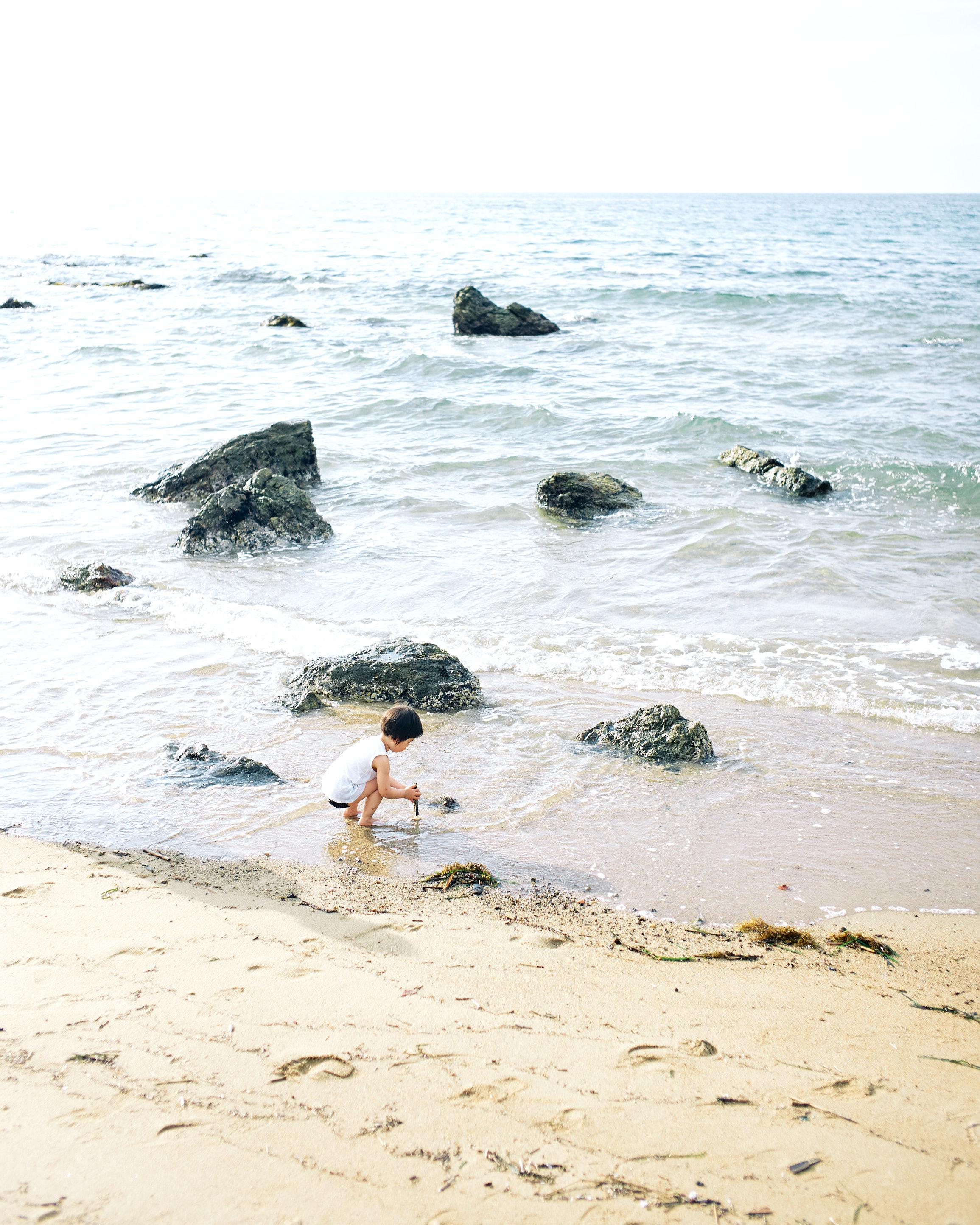 kid playing at itoshima beach during summer