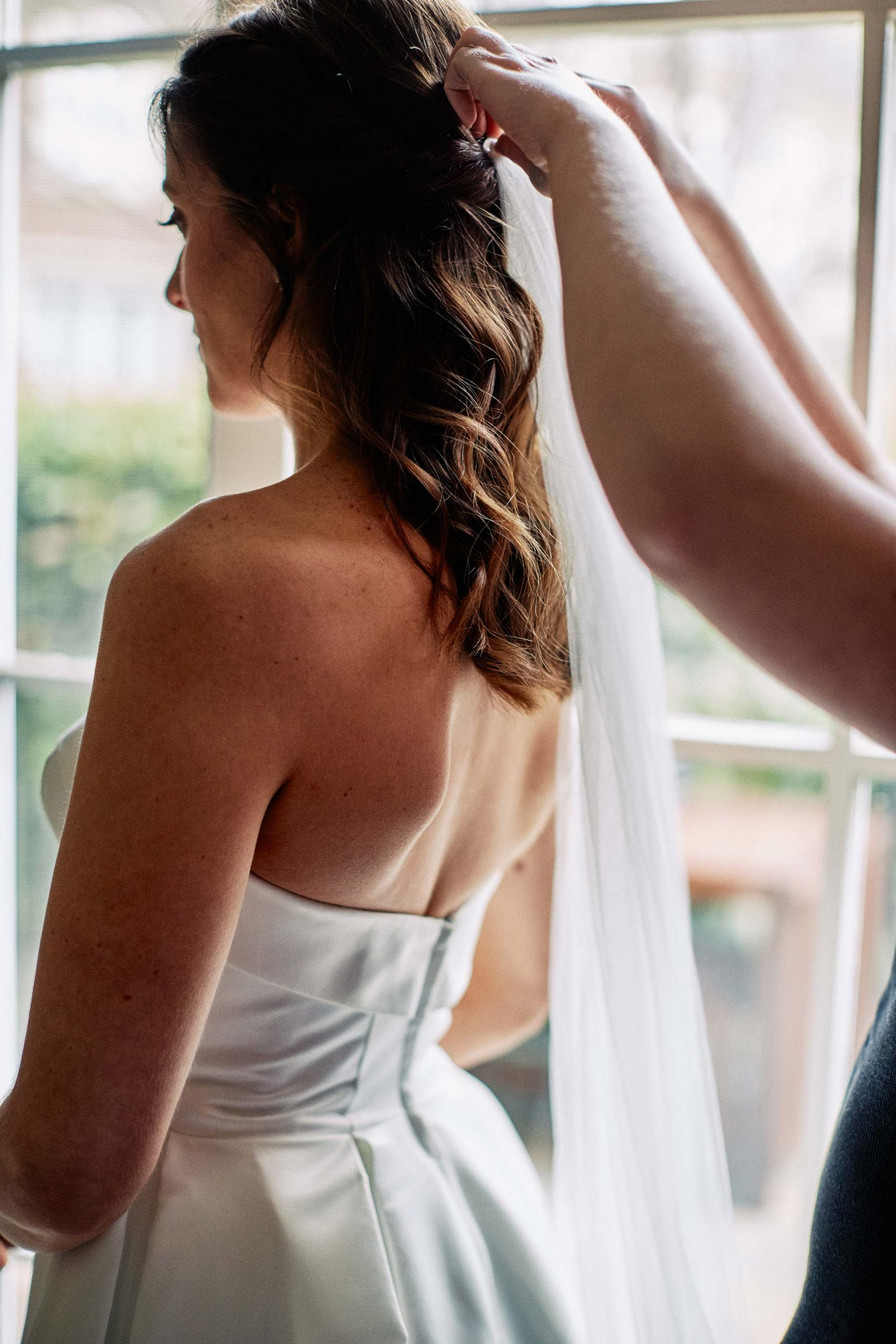 East Melbourne Wedding bride getting ready dress veil