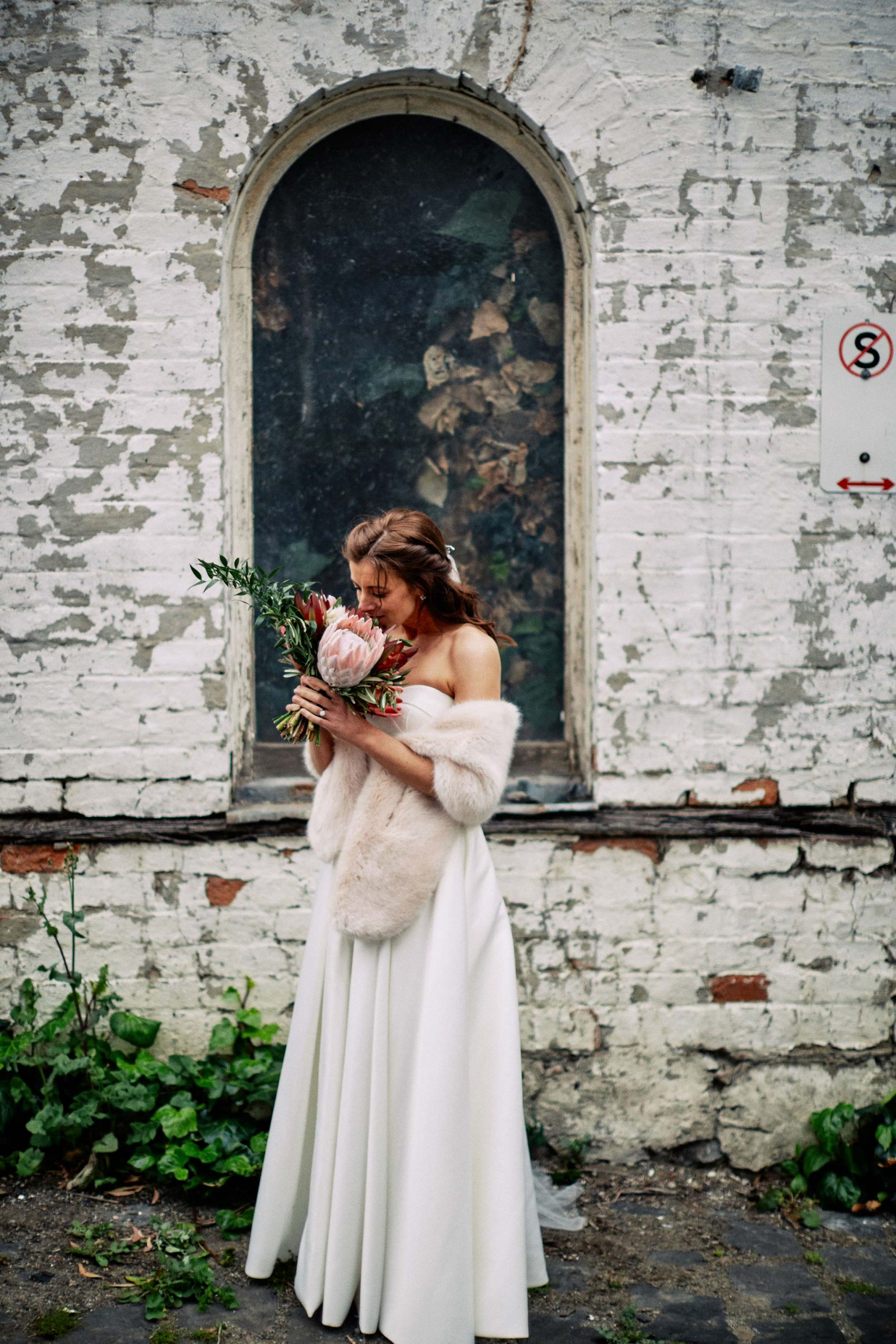 East Melbourne Wedding Photographer Bride Posing with flower