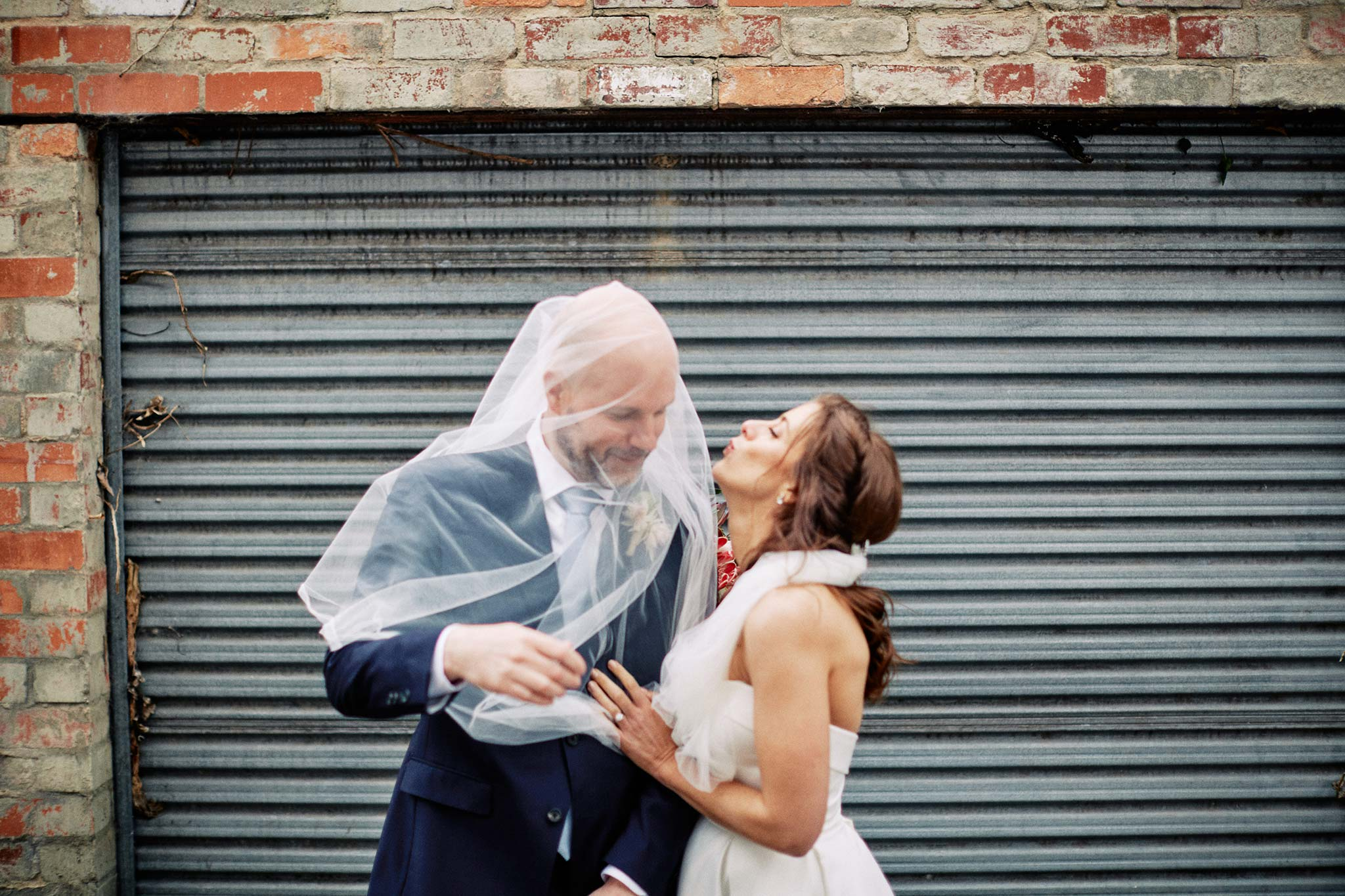 East Melbourne Wedding Photographer Bride Groom Veil Moment