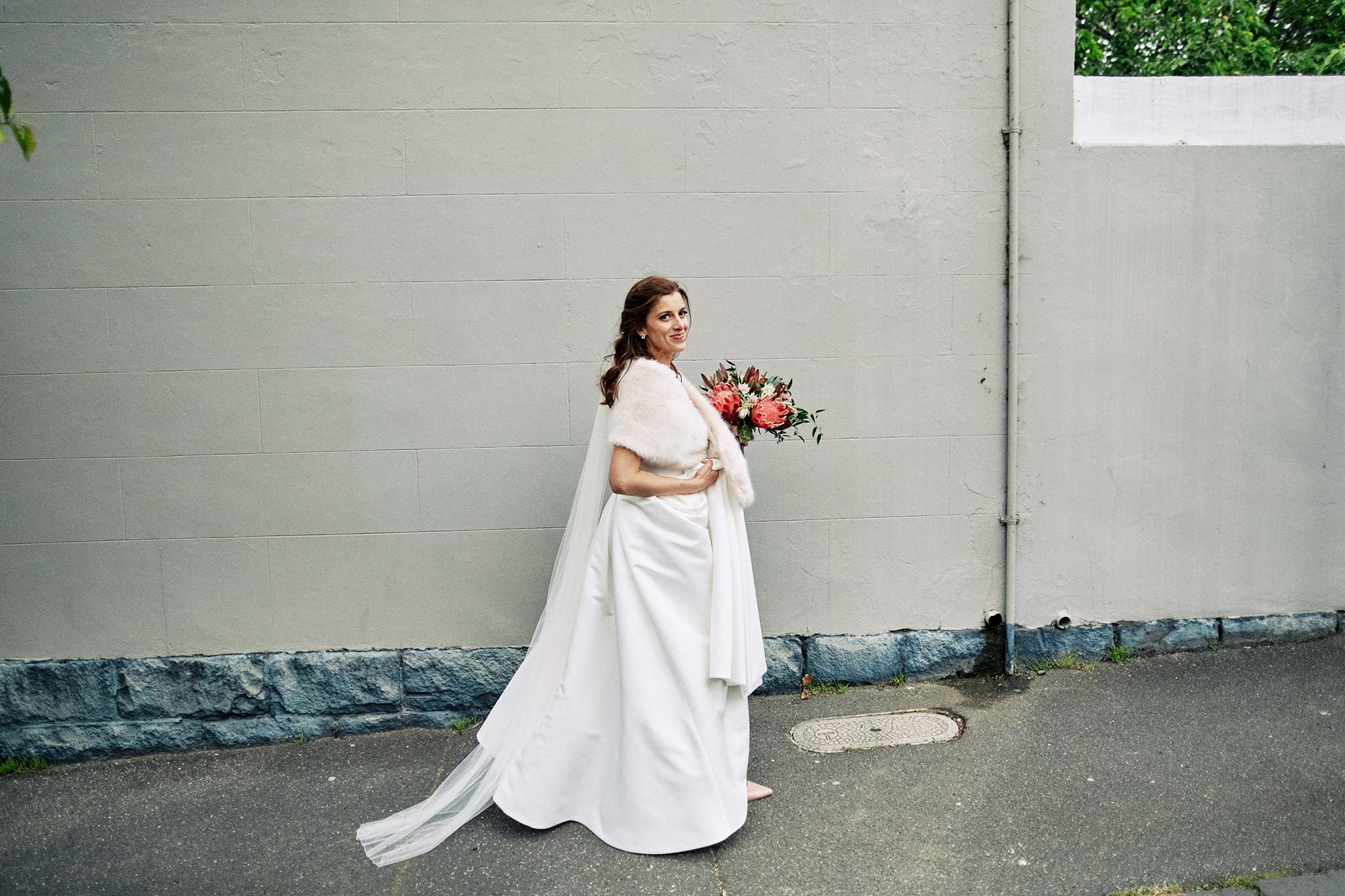 East Melbourne Wedding Photographer Bride walking in dress