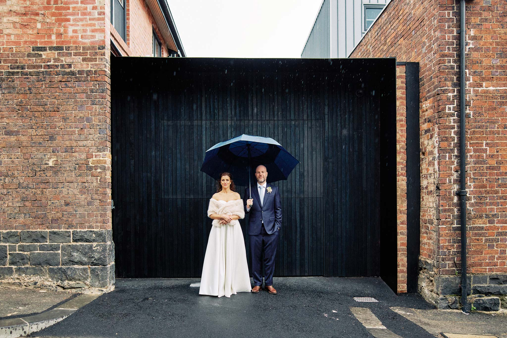 East Melbourne Wedding rain portrait bride groom umbrella