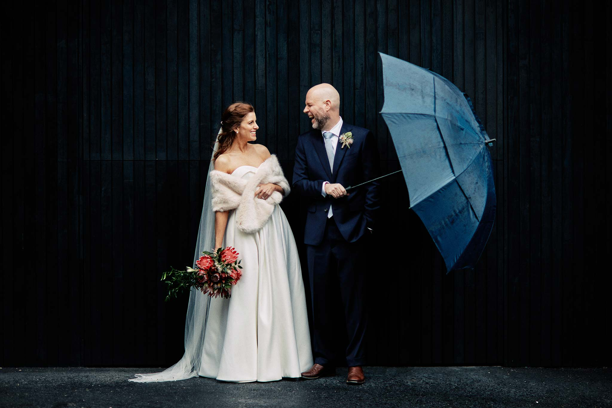 East Melbourne Wedding rain portrait bride groom umbrella elegant